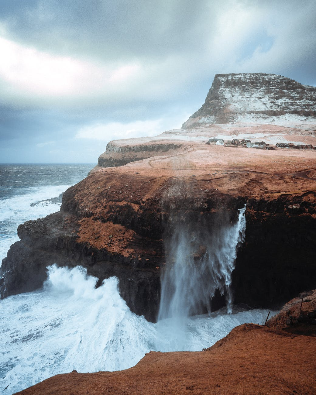 stormy sea with rocky cliffs in daylight